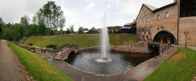 Beautiful fountain in park at the openwork bridge. Stock Photography