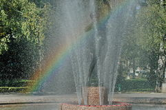 Beautiful fountain with rainbow Stock Images