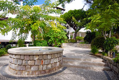Beautiful fountain in scenic cobblestone patio, Algarve, Portuga Stock Image
