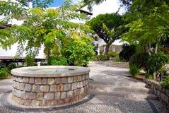 Beautiful fountain in scenic cobblestone patio, Algarve, Portuga Stock Image