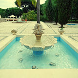 Beautiful fountain in scenic cobblestone patio, Algarve, Portuga Royalty Free Stock Photo