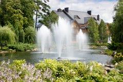 Beautiful fountains on lake at botanical garden Royalty Free Stock Image