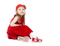 Beautiful four-year-old girl in a red dress Stock Photos