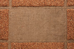Beautiful frame with buckwheat on sackcloth Royalty Free Stock Photography