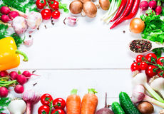 Beautiful frame of different vegetables and spices on the white boards with free space for you text. Studio photography of healthy organic eating royalty free stock images