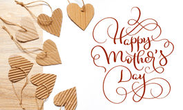 Beautiful frame of hearts of kraft paper and text Happy mothers day. Calligraphy lettering hand draw.  Royalty Free Stock Photos