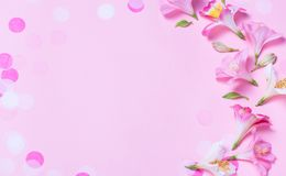Beautiful frame made from pink flowers and pink confetti on pink background. stock illustration