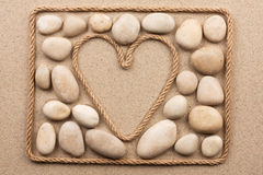 Beautiful frame of rope in the form of heart with white stones Stock Photos