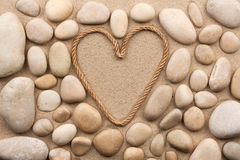 Beautiful frame of rope in the form of heart with white stones Royalty Free Stock Photos