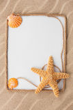 Beautiful frame of rope and star and sea shells with a white bac Royalty Free Stock Photography