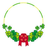 Beautiful frame in shape of wreath with clover and bow Royalty Free Stock Photo
