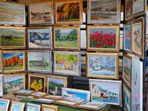 Beautiful framed oil paintings for sale at a street stand. Cluj-Napoca, Romania - May 20,2018: Beautiful framed oil paintings for sale at a street stand royalty free stock photography