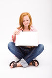 Beautiful freckled teen with computer stock images