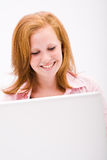 Beautiful freckled teen with computer Royalty Free Stock Photography