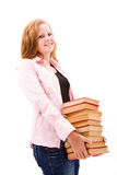 Beautiful freckled teen girl. A beautiful freckled teen girl with books Royalty Free Stock Image