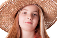 Beautiful freckled young girl wearing straw hat Stock Images