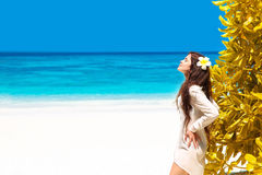 Beautiful free woman enjoying on exotic beach in summer by tropi Royalty Free Stock Photos