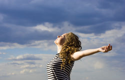 Beautiful free woman over the blue sky Stock Images