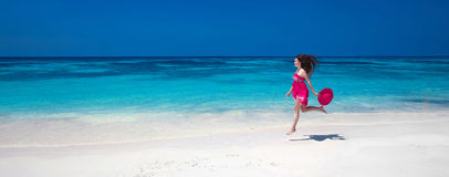 Beautiful free young woman jumping on the exotic sea, happy brun Royalty Free Stock Images