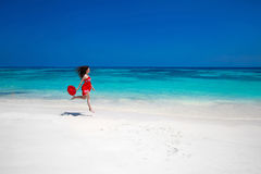 Beautiful free young woman jumping on the exotic sea, happy brun Stock Photos
