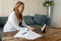 Beautiful freelance woman consultant having a video conference call with online client at home royalty free stock photos