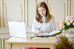 Beautiful freelancer female talking in a video conference Stock Photography