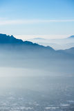 Beautiful french alps winter panoramic aerial view landscape with a fantastic blue haze cloudy mountain background Stock Image