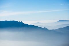 Beautiful french alps winter panoramic aerial view landscape with a fantastic blue haze cloudy mountain background Royalty Free Stock Photo
