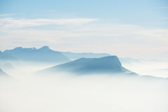 Beautiful french alps winter panoramic aerial view landscape with a fantastic blue haze cloudy mountain background. Beautiful french alps winter panoramic aerial Stock Image