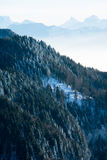 Beautiful french alps winter panoramic aerial view landscape with a fantastic blue haze cloudy mountain background Royalty Free Stock Photography
