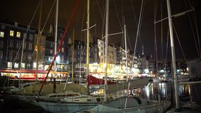 Beautiful French city at night, boats and yachts parked near embankment stock video footage