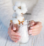 Beautiful French manicure and cotton flower Royalty Free Stock Photography