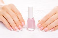 Beautiful french manicure isolated on white Royalty Free Stock Image