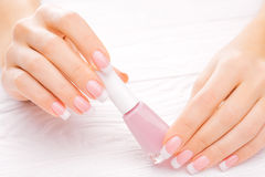 Beautiful french manicure isolated on white Stock Photo