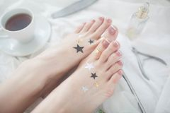 Beautiful French pedicure on a white background. stock image