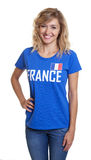 Beautiful french sports with blond hair and blue jersey Stock Images