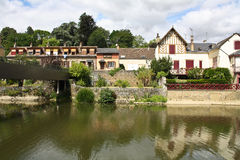 Beautiful French village. Beautiful postcard of a peaceful French village behind a river royalty free stock photography