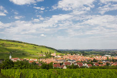A beautiful French village in the Alsace with church among vineyards. A beautiful French village in the Alsace region with church among green vineyards Stock Photo