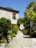 Beautiful french village Ardeche. The beautiful french village Balazuc in the Ardeche. This is one of the houses with a beautiful and colourful garden Stock Photo