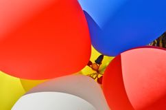 Beautiful fresh colors of balloons close up. Beautiful fresh colors of balloons with rubbers at pole close up royalty free stock photo