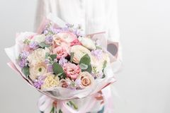 Beautiful fresh cut bouquet of mixed flowers in woman hand. the work of the florist at a flower shop. Delicate Pastel. Beautiful fresh cut bouquet of mixed royalty free stock image