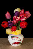 Beautiful Fresh Cut Tulips. A vase full of fresh cut spring tulips Stock Photos