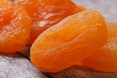 Beautiful fresh dried apricots close up on an old wooden table. Stock Image