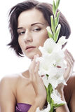 beautiful fresh face with gladiolus flowers Stock Photography