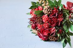 Beautiful fresh flower arrangement of red roses and text copy space. stock photo