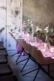 Beautiful fresh flowers champagne glasses at wedding ceremony aisle closeup. Beautiful fresh purple flowers champagne glasses at wedding ceremony aisle closeup royalty free stock photos