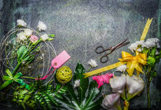 Beautiful fresh flowers, pair of scissors and tools to create bouquet on rustic background, top view Stock Photos
