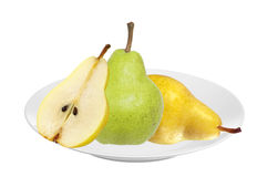 Beautiful fresh green and yellow pears on plate isolated on whit Royalty Free Stock Image