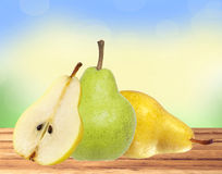 Beautiful fresh green and yellow pears on wooden table Royalty Free Stock Photo