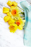 Beautiful fresh narcissus  and tulips on white wooden background Stock Photography